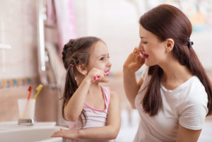 Little-Kid-Girl-And-Mom-Brushing-teeth.jpg